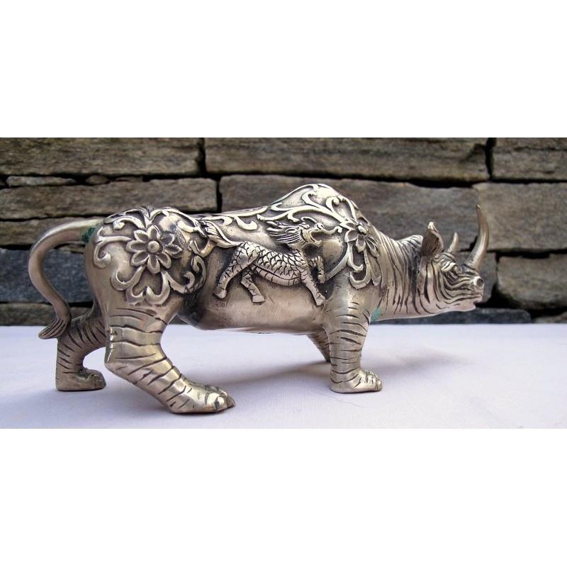 silver metal rhinoceros