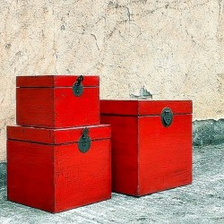Nest of three red lacquered...