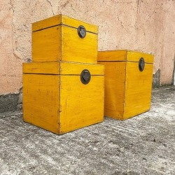Nest of three yellow lacquered trunks