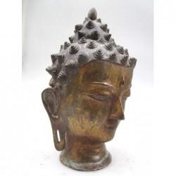 Buddha head in gilt bronze
