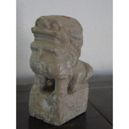 Chinese guardian lion in natural stone